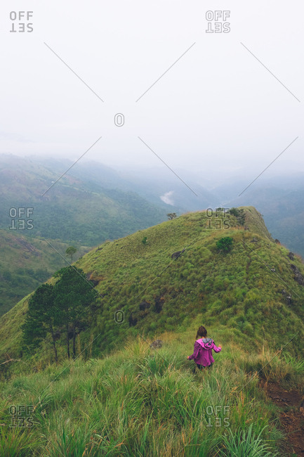 Woman walking through hills of Ella, Sri Lanka