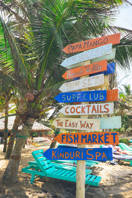 Mirissa, Sri Lanka - August 17, 2017: Colorful sign on a beach