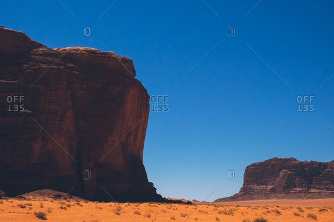 Rock formation under blue skies in the Wadi Rum desert, Jordan