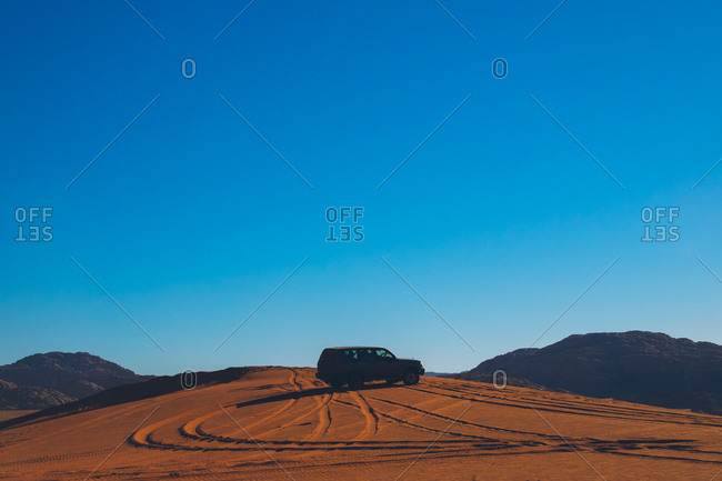 Car parked in the Wadi Rum desert, Jordan