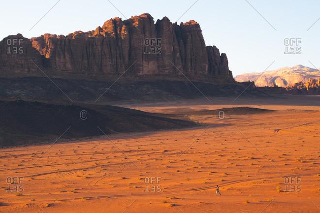 Man walking in the Wadi Rum desert, Jordan