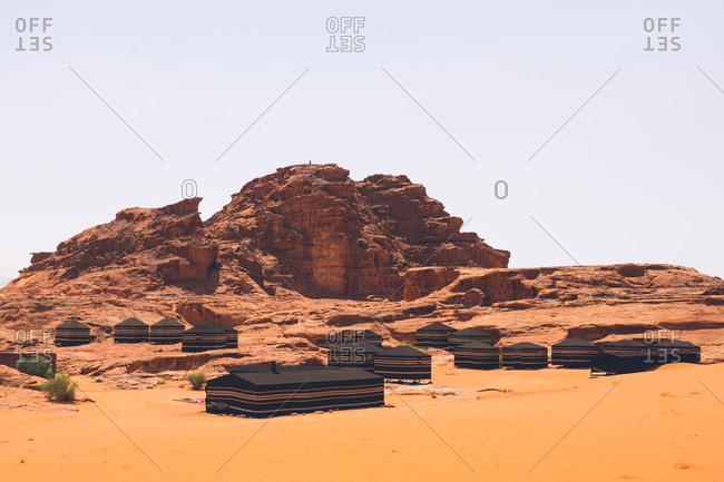 Several black tents in the Wadi Rum desert, Jordan