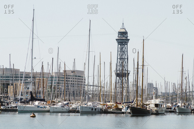 Spain, Barcelona - June 27, 2012: Boats moored in river against clear sky