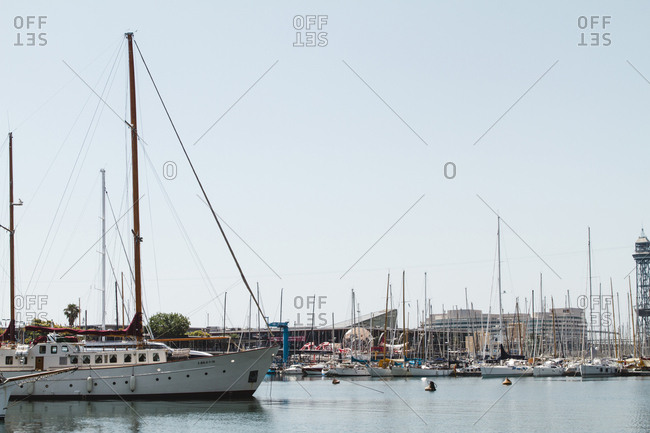 Spain, Barcelona - June 27, 2012: Boats moored in river at port against clear sky