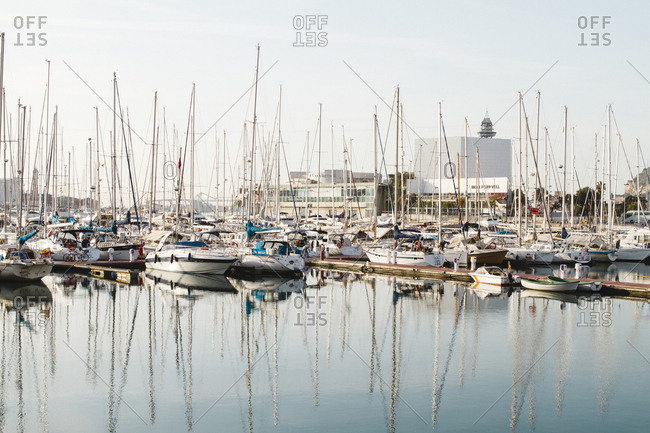 Spain, Barcelona - January 21, 2012: Boats moored in river against sky