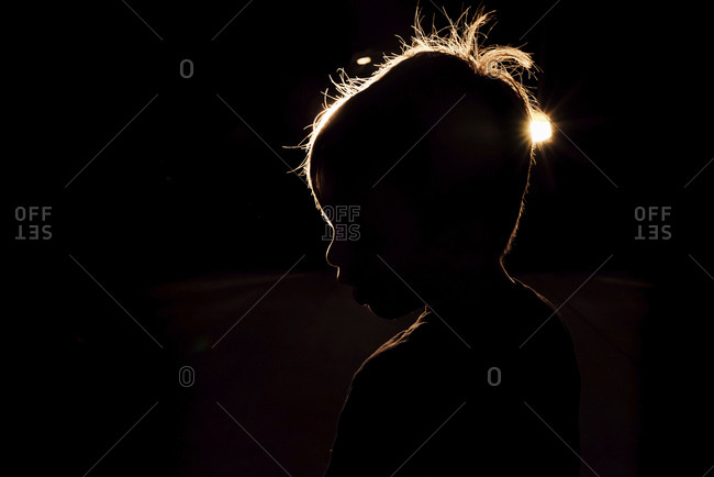 Side view of boy in darkroom