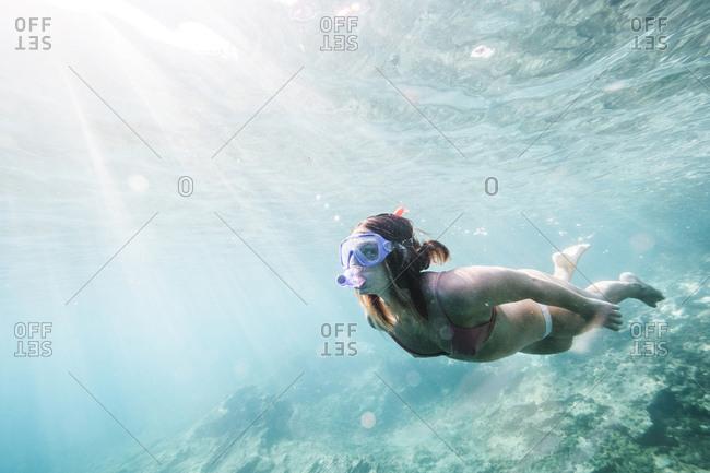 Full length of woman scuba diving undersea