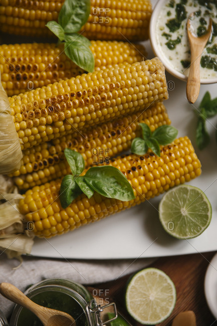 Close-up of roasted corn served in plate on table