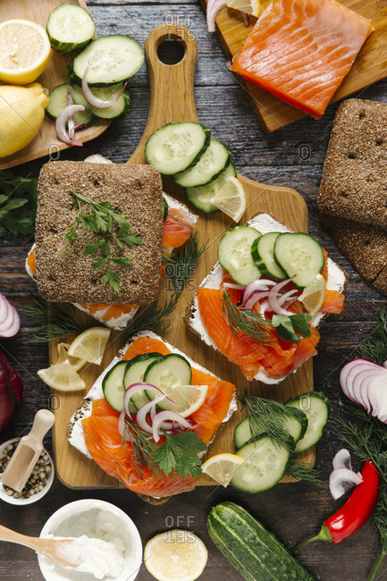 Close-up of salmon and vegetables sandwich on cutting board