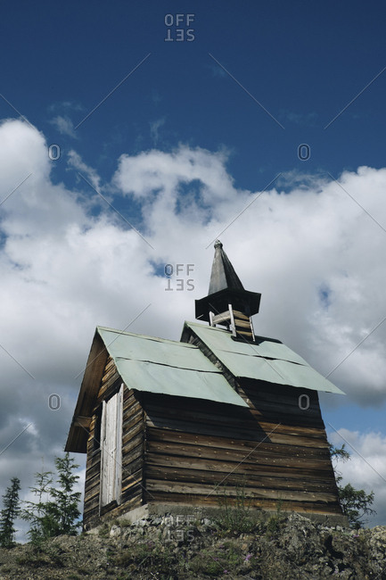 Low angle view of wooden church against cloudy sky