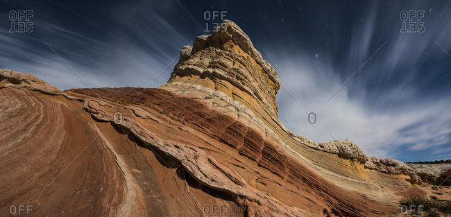 Low angle view of rock formations against cloudy sky at Marble Canyon