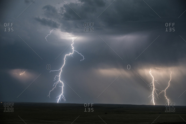 Low angle majestic view of thunderstorm and lightning at Badlands National Park