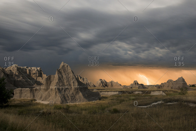 Majestic view of rock formations at Badlands National Park against thunderstorm and lightning