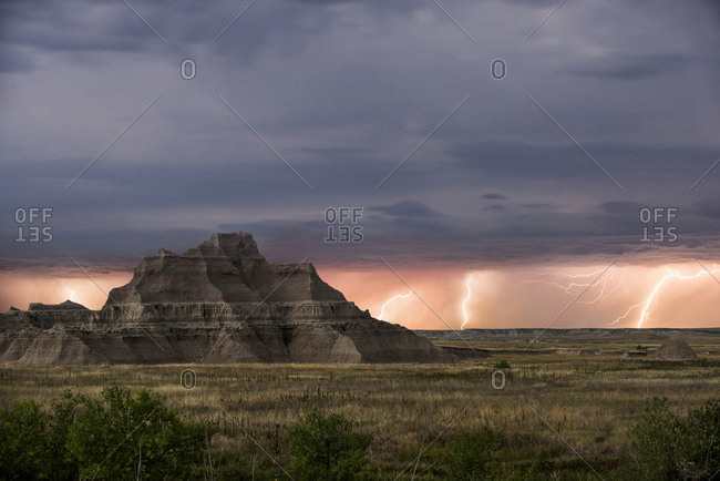 Scenic view of rock formations at Badlands National Park against thunderstorm and lightning