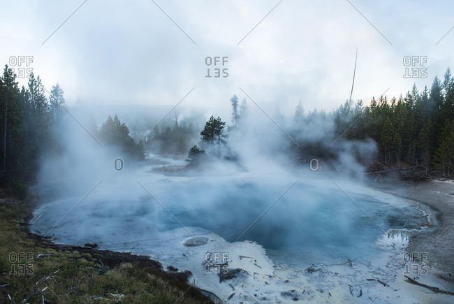 Scenic view of steam emitting from hot spring at Yellowstone National Park