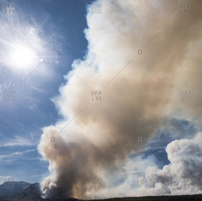 Low angle view of smoke emitting from mountains during forest fire at Grand Teton National Park