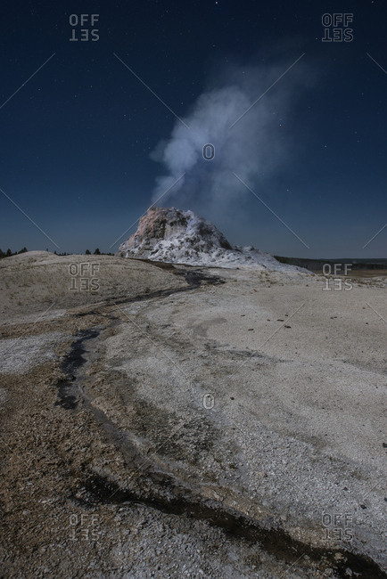 Scenic view of hot spring at Yellowstone National Park against sky