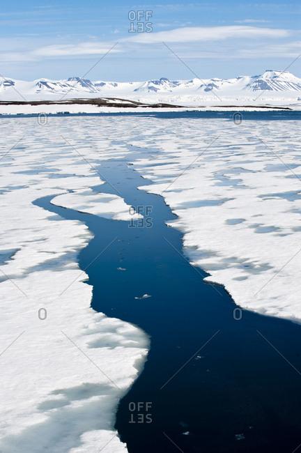 Breaking pack ice at Hornsundet, south west coast of Spitsbergen, Svalbard, Arctic Norway, June 2009