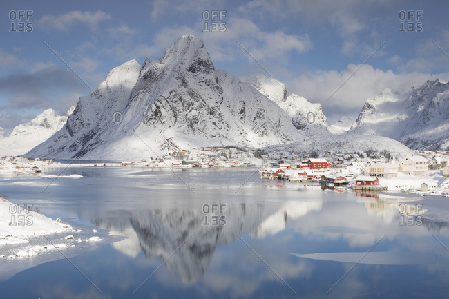 Reine village, Moskenes, Nordland county, Norway - March 9, 2013: Winter clouds passing over mountain summit