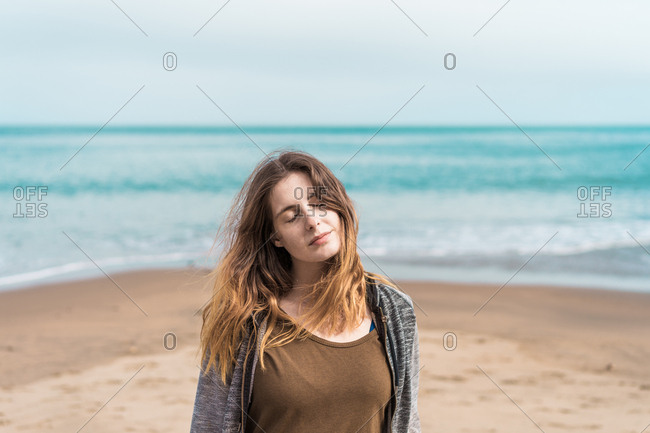 Woman posing on blue ocean