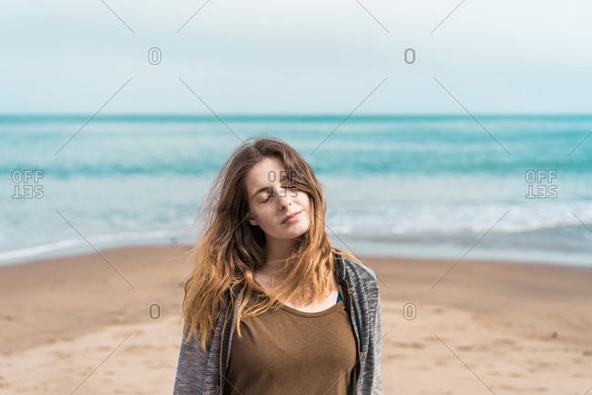 Woman posing on blue ocean