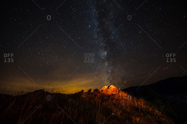 Landscape with mountains and milky way at night