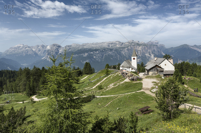 Scenic view of mountains with the beautiful little Church of the Holy Cross, Badia Valley, Dolomites, South Tyrol, Italy