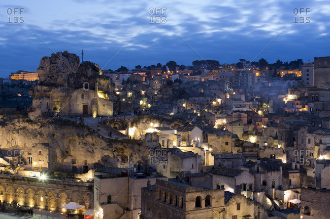 Overview of Sassi di Matera at dusk, one of the three oldest cities in the world, Basilicata, Italy