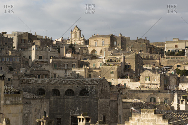 Buildings on upper side of the Sassi, Matera, one of the three oldest cities in the world, Basilicata, Italy