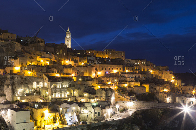 View of Sassi di Matera at night with the cathedral bell tower, one of the three oldest cities in the world, Basilicata, Italy