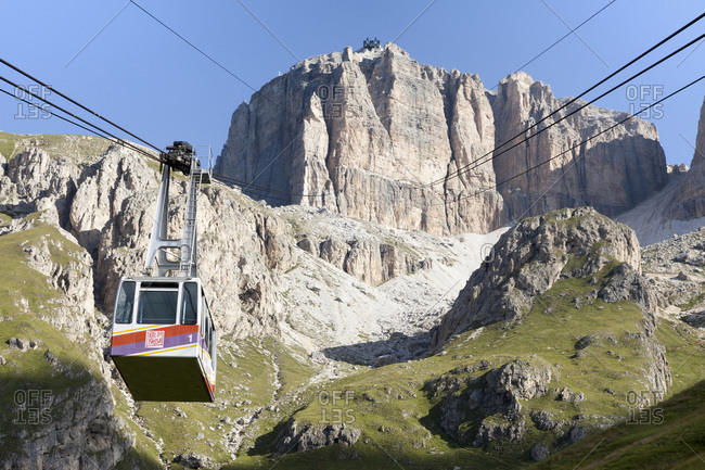 Cable car assending the rocky plateau of the Sella Group, Dolomites, Trentino Alto Adige, Italy
