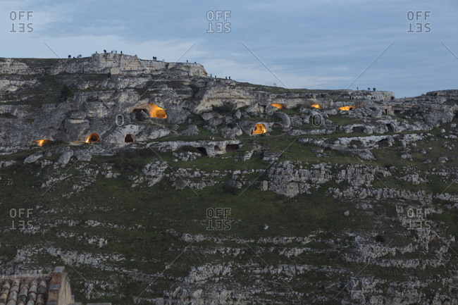 Sassi of Matera at dusk, with ancient cave dwellings and rock churches, Murgia of Matera Park, Matera, Basilicata, Italy