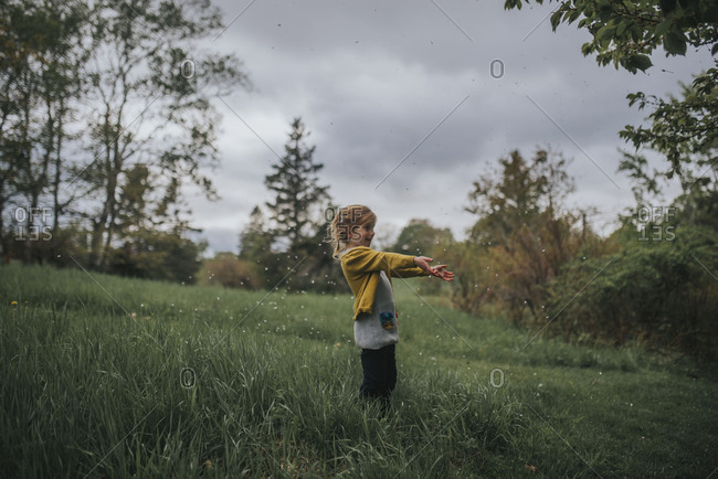 Girl playing alone in meadow