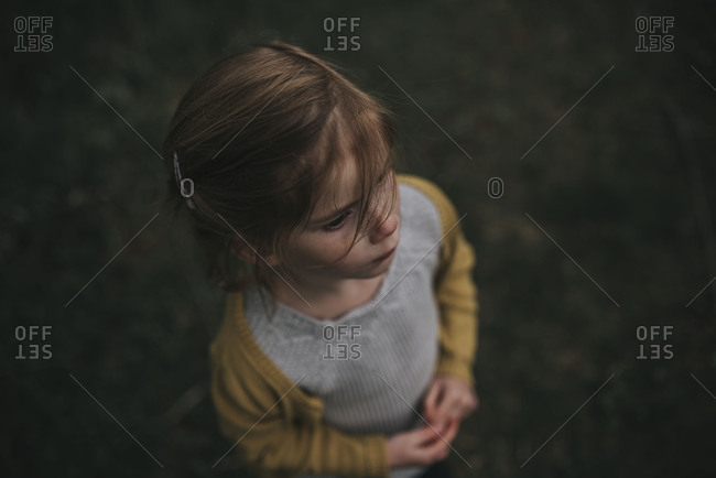 Portrait of a girl standing outside looking away