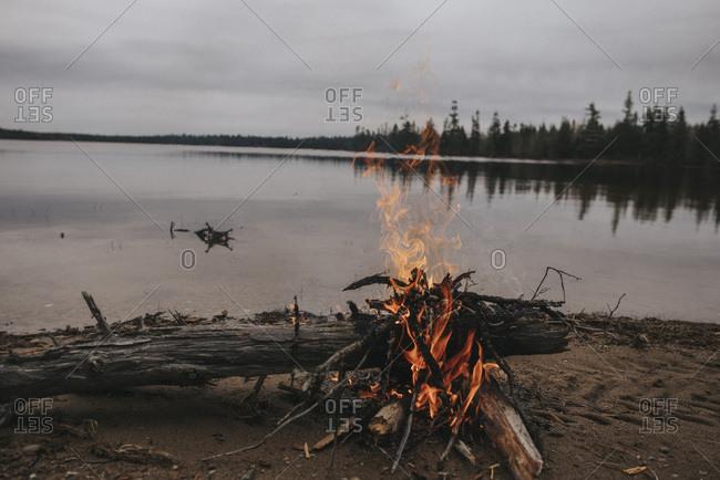 Campfire at the shore of a lake
