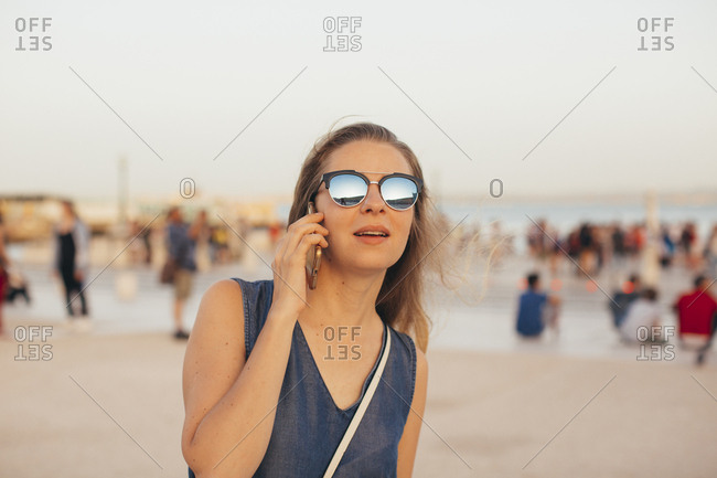 Young woman wearing sunglasses talking on phone