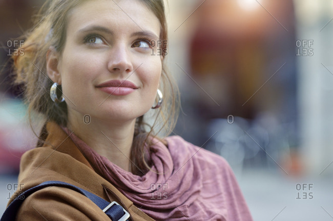 Relaxed smiling woman portrait looking up outdoors