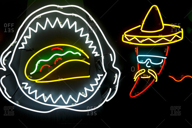 Los Angeles, California, USA - October 20, 2017: Neon sign of taco and chili pepper at Grand Central Market