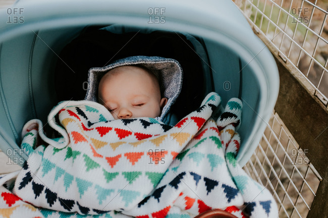 Sleeping baby in a stroller