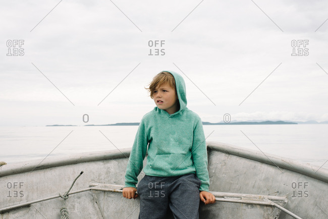 Boy looking into the distance from a boat