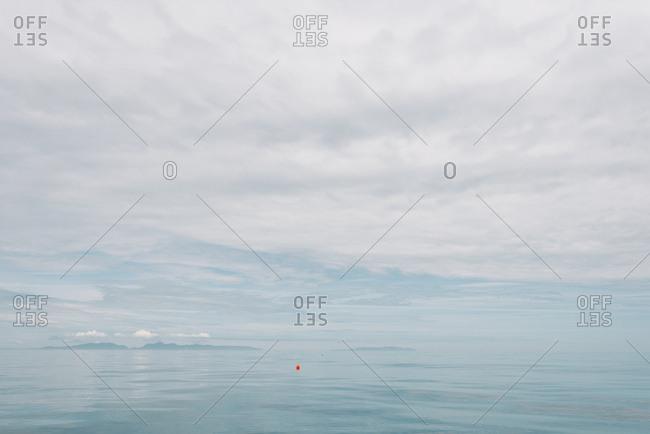 Alaskan ocean landscape with fishing buoy