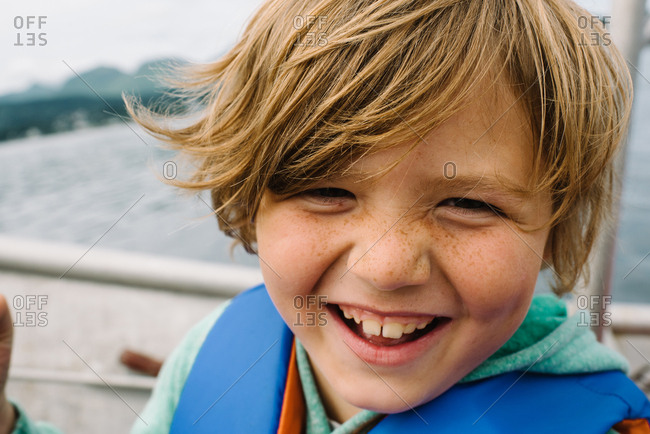 Portrait of a little boy with freckles on a boat