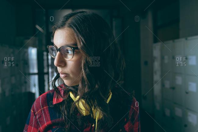 Thoughtful girl standing in locker room