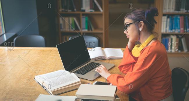 Girl using laptop at desk