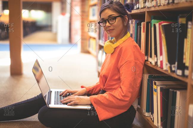 Portrait of confident girl using laptop