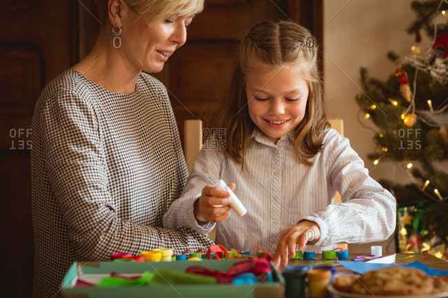 Mother and daughter preparing christmas decoration