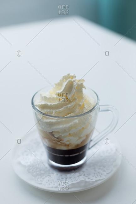 Mug of ice cream on the table