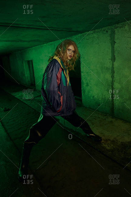 Model posing in river of sewage in tunnel under the city