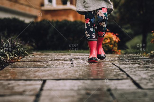 Girl walking in rain boots