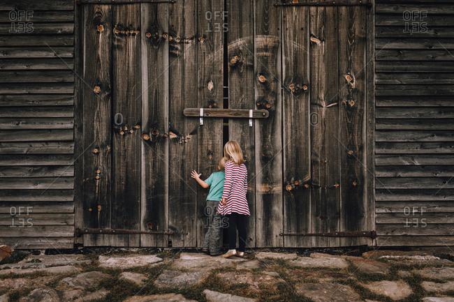Kids looking in barn